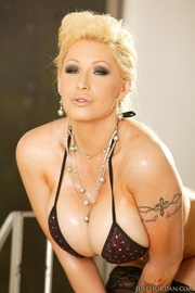 seductive blonde wearing burgundy