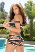 Fair brunette in a black printed lacy garment makes sure she pleasures