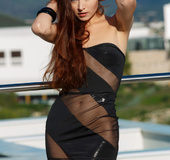 Ravishing brunette in revealing black dress shows tits and shaved pussy