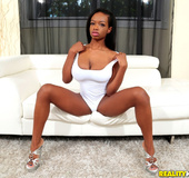 Busty black gal in white bodysuit gets white cum covered after giving