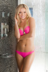 Beautiful blonde sweet smile enjoying waterfall shower in pink bikini,