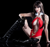 Sexy white vampire in red suit showing her large breasts and wears latex