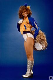 brown-eyed brunette cheerleader with