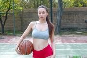 brown-eyed brunette basketball player