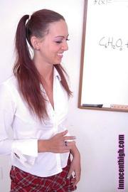 gaudy brunette wearing schoolgirl