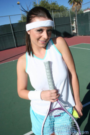 brunette wearing sweatband gets