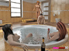 Three women become dominating to a single man in the hot tub.