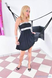 high heeled blonde undressing