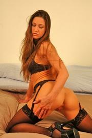 brunette temptress black lingerie