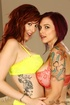 Juicy short haired tattooed babe in sexy lingerie and redhead friend wearing