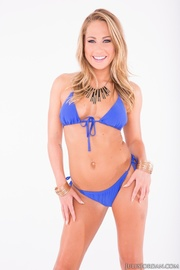 blonde poses blue bikini