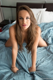 brunette strips blue bed