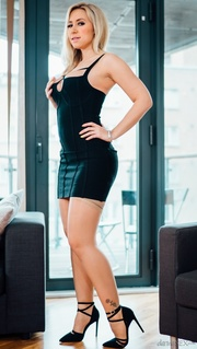 shapely blondein black dress