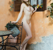 Angelic beauty with puffy nipples parades her naked body on patio