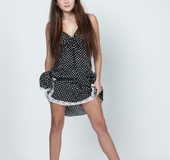 Barefoot brunette in polka dot dress stips to reveal her yummy pussy