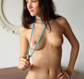 Divine brunette wearing long teal necklace showing off her pretty lickable