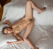Petite brunette with white furry lingerie loves to show her tiny pink
