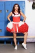 Red-lipped shemale slowly wiggles out of red cheerleader outfit and white