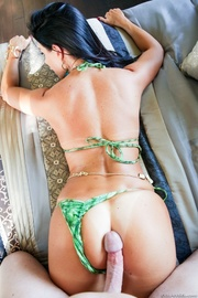 green bikini exotic brunette