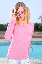 pigtailed blonde glasses posing