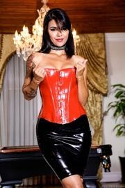 inked brunette red corset