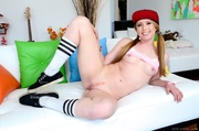 snapback-wearing blonde lifting her