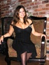 Busty jezebel in dark stockings works her way out of a hot black cocktail