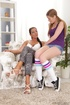 Teen in sporty knee-high socks laps at a MILF's pussy with great intensity.