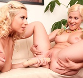 Older blonde enjoys lesbian toy play with a young and eager hottie.