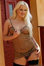 seductive tattooed blonde sheer