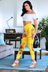 This hot, brunette, slut dressed in white and yellow poses for the camera