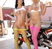 Two big titted sluts are wearing slutty stockings while fucking with one