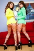 Steaming hot chicks pose their banging bodies in yellow and in green dresses,