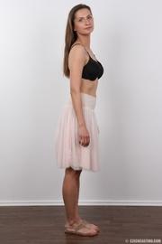 conservative looking brunette undresses