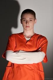 short-haired prisoner undressing showing