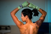 exotic tattooed fighter ponytail