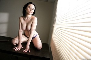 Pale brunette with huge tits posing on a - XXX Dessert - Picture 9