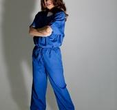 Prison jumpsuit taken off by a busty hazel-eyed brunette
