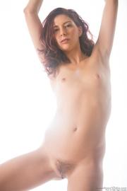 window-side posing curly redhead