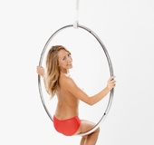 Sporty blonde posing naked on this circle-thing