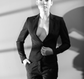 Short-haired brunette takes off her manly clothes in B/W