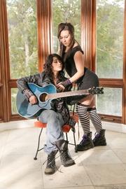 curly rock-star brunette makes