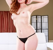 Grey-eyed redhead with a big butt takes off her panties