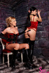 Not too shabby blonde and brunette wearing red and black lace up corsets