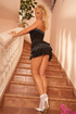 blonde lifts her dress