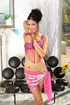 Tall brunette in pink indian outfit teasing on a cam while posing in black