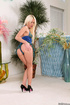 High heeled blonde posing in short blue dress and flashing tight blue