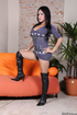 Red lipped shemale in black boots and short grey dress posing and showing