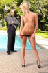 Tattooed blonde with small tits stripteasing by the pool and enjoying
