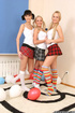 Two blondes in striped socks and pigtailed brunette sucking lollipops